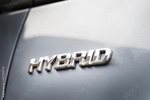 Hybrid inscription on the body of a modern car Fototapete