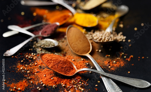 Canvas Prints Spices Various spices and herbs on black background