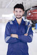 Arabian car mechanic smiling in workshop