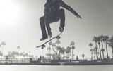 Fototapeta Fototapety dla młodzieży do pokoju - Skater boy practicing at the skate park