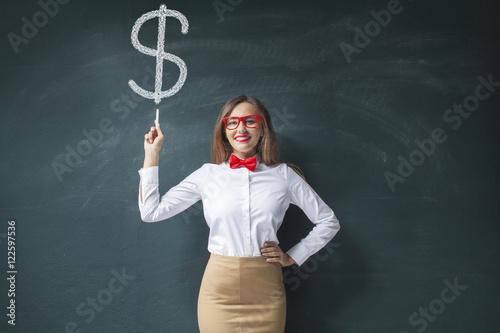 Fototapeta  Businesswoman at Blackboard