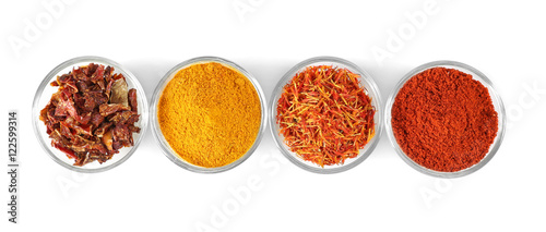 Canvas Prints Spices Glass bowls with various spices in a row on white background