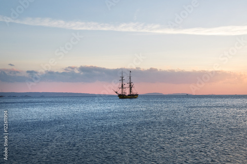 Canvas Prints Ship sailing ship at anchor, a blue calm sea and cloudless sky