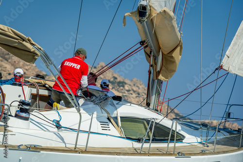 Foto op Aluminium Zeilen Sailboat bow with hoisted headsail and copy space on the boat hull.