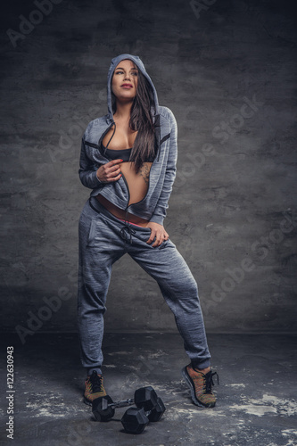 Dapper sexy female in grey hoodie  - Buy this stock photo and