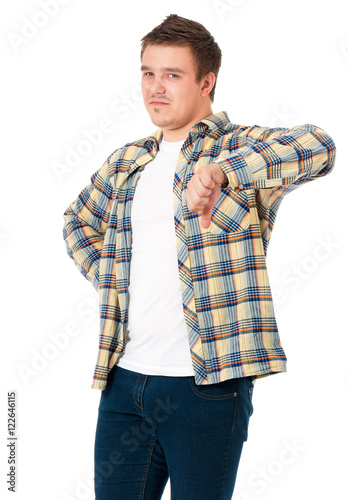 a9d84f66 Young casual man show the thumb down negative hand sign, isolated on white  background. Disappointed handsome guy making bad sign and making sad a face.