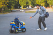 kid riding electric tricycle