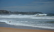 Swimmer on Deserted Beach. Manly beach is one of the famous beach in Sydney, NSW, Australia.