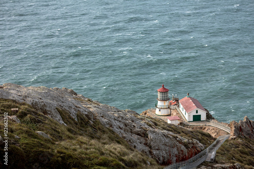 Lighthouse on cliffs, high angle view - Buy this stock photo