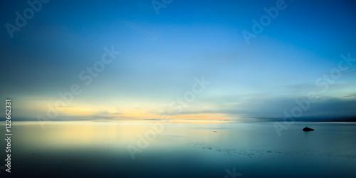 Calm ocean bay at sunrise