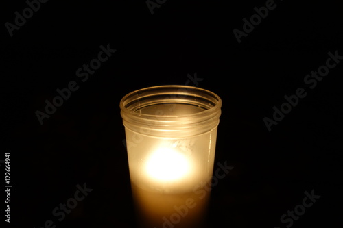 Memorial candle on black background Wallpaper Mural