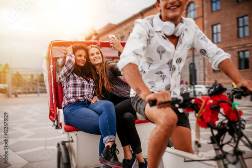 Fotografering  Female friends taking selfie on tricycle