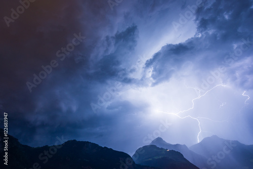 Photo sur Toile Tempete Lightning over the mountains, thunderbolt.