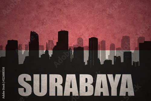 abstract silhouette of the city with text surabaya at the vintage indonesian flag background buy this stock illustration and explore similar illustrations at adobe stock adobe stock adobe stock