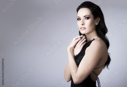 Valokuva Studio portrait of young beautiful brunette woman in black lace