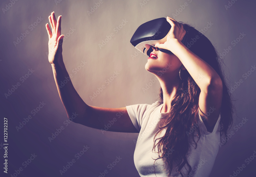 Fototapeta Woman using a virtual reality headset
