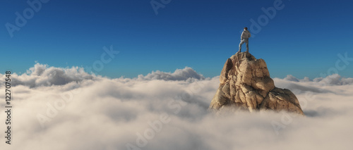 Fototapeta A man standing on a stone cliff obraz