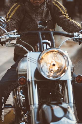 Photo  Man on bike in leather jacket
