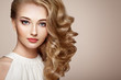 Leinwanddruck Bild - Fashion portrait of young beautiful woman with jewelry and elegant hairstyle. Blonde girl with long wavy hair. Perfect make-up.  Beauty style woman with diamond accessories