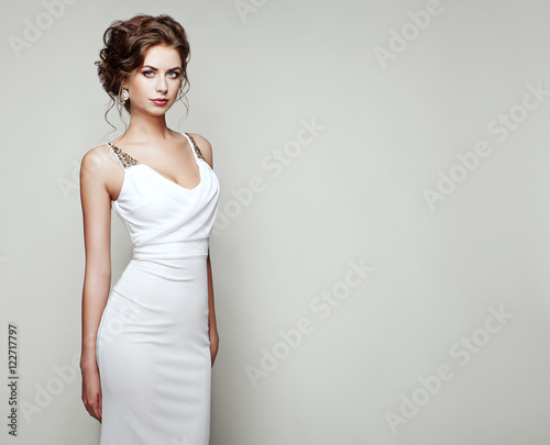 Fotografija  Fashion portrait of beautiful woman in elegant white dress
