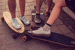 Skaters legs on Longboards.