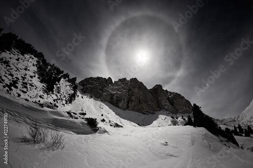 Valokuva Full moon with halo in Small Almaty Gorge, Tian Shan mountains, Kazakhstan