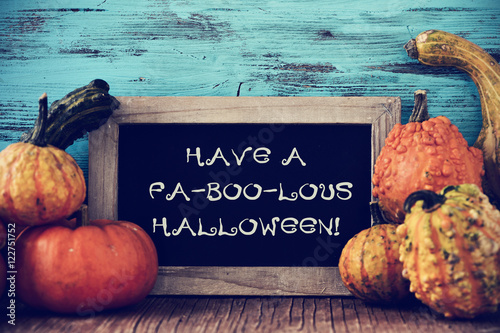 Fotografia, Obraz  pumpkins and chalkboard with text have a fa-boo-lous halloween