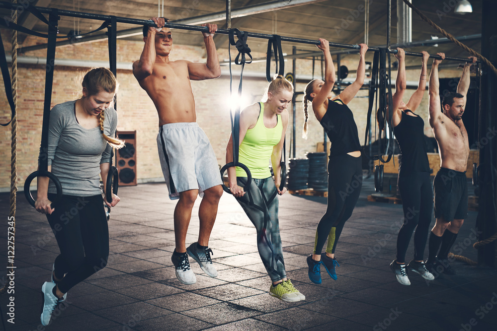 Fototapety, obrazy: Adults doing chin ups for cross fit training