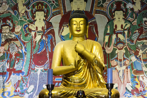 Golden Buddha in the ancient temple Canvas Print