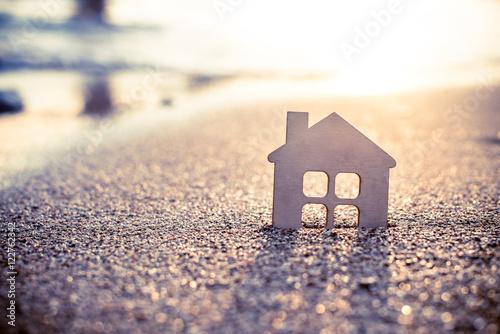 Fototapeta symbol of the house at sunset on the seashore  obraz