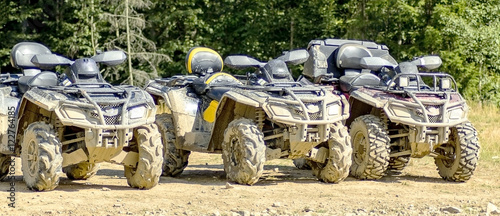 ATV in mud after riding through the woods.