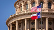 canvas print picture - American and Texas state flags flying on the dome of the Texas State Capitol building in Austin
