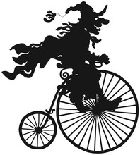 Halloween Witch Riding An Antique Bicycle