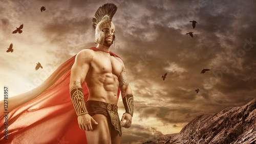 Foto  Medieval warrior standing in front of the gloomy clouds