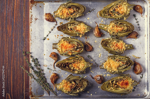 Valokuva  Artichokes baked with cheese, garlic and thyme.