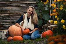 Girl With Pumpkin. Stump. Sunflower