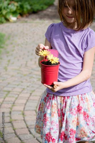 8 year old girl also enjoys gardening Poster