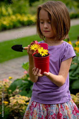 Photo  8 year old girl also enjoys gardening