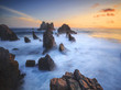 Amazing stones at beach in sunset. Locations in Pegadung Beach Lampung, Indonesia.