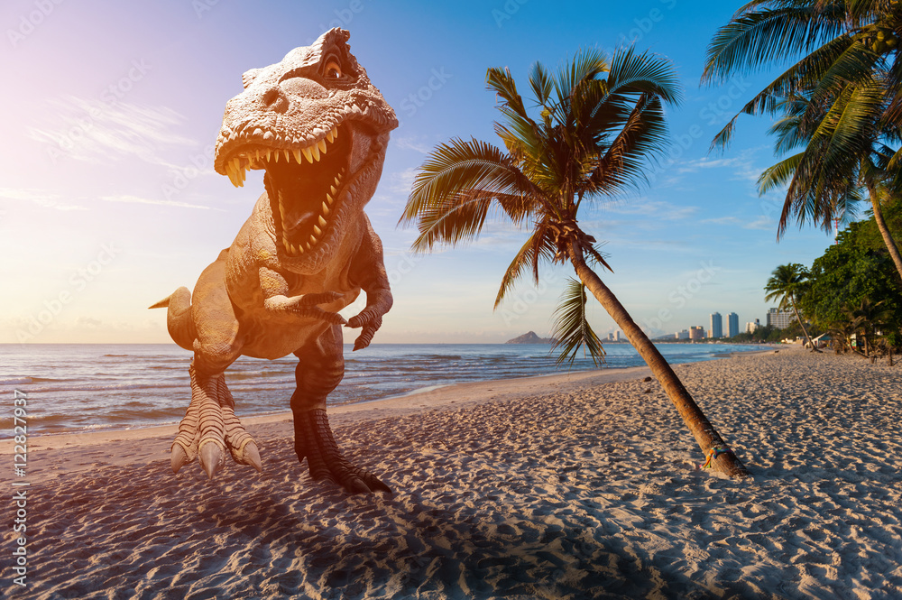 Fototapety, obrazy: Dinosaur model on the beach in the morning