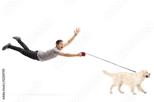 Guy being pulled by his dog Canvas Print