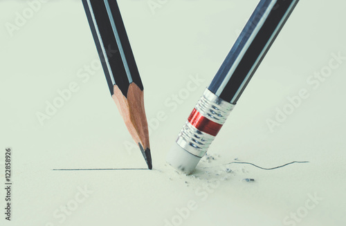 Close up of a pencil eraser removing a crooked line and the clos Wallpaper Mural