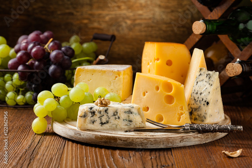 Mix cheese on wooden board. Canvas Print