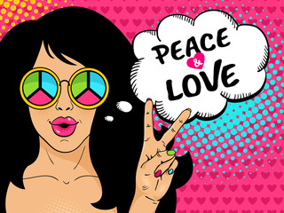 Wow pop art female face. Sexy hippie girl in glasses with pacific sign shows victory sign and peace and love speech bubble. Vector colorful background in pop art retro comic style.