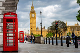 Fototapeta Big Ben - Big Ben on a Cloudy Spring Day with Traditional Red Phone Booths in Foreground