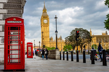 Big Ben On A Cloudy Spring Day With Traditional Red Phone Booths In Foreground