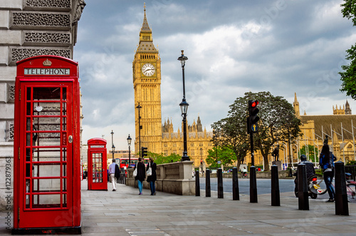 Fotografie, Obraz  Big Ben on a Cloudy Spring Day with Traditional Red Phone Booths in Foreground