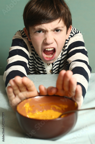 Leinwand Poster boy refuse from eating smashed pumpkin soup