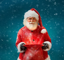 Smiling Santa Claus With Open Sack And Looking At Camera. Merry Christmas & New Year's Eve Concept.