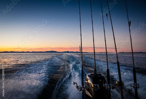 Fotografia, Obraz Fishing boat with wake at Dawn Sea of Cortez